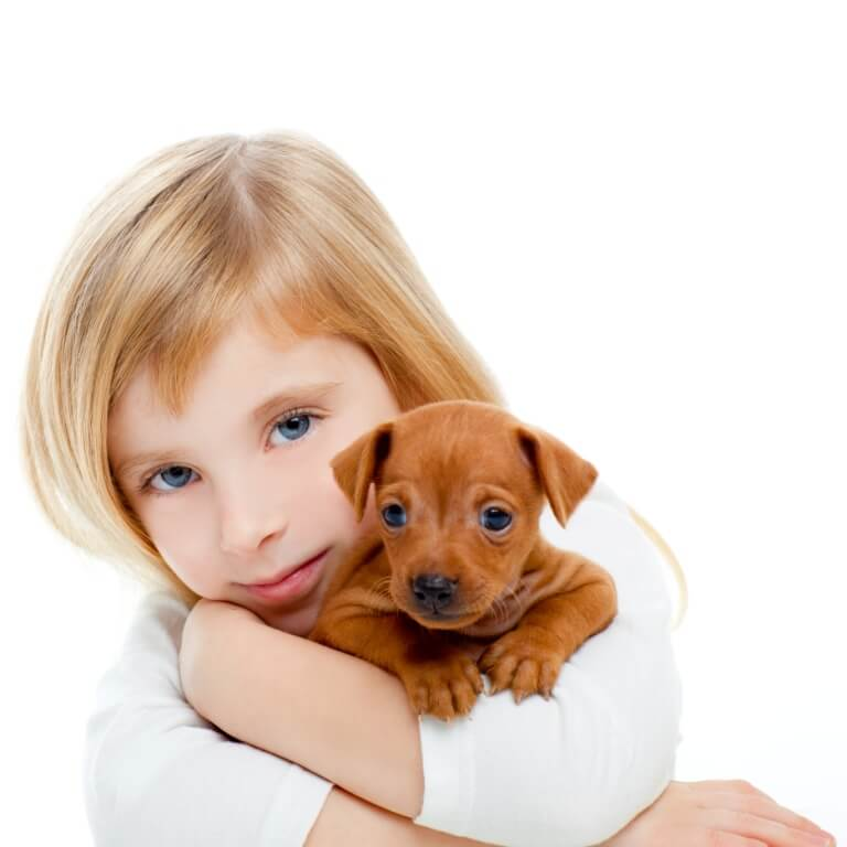 a girl with a puppy in her hands